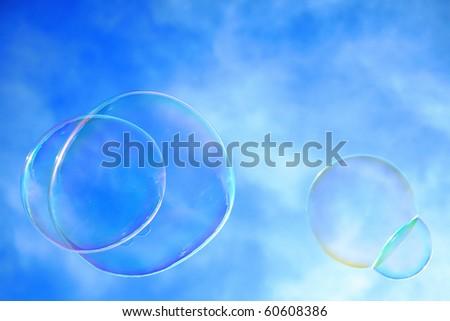 Colorful bubbles against a blue sky - stock photo