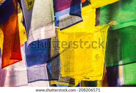 Colorful buddhist Prayer flags with mantras. religion in Asia