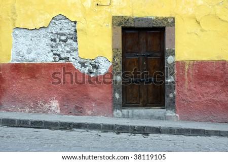 Colorful building and doorway in San Miguel de Allende, Mexico. - stock photo