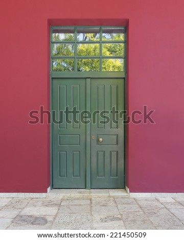colorful building detail, green door, red wall - stock photo