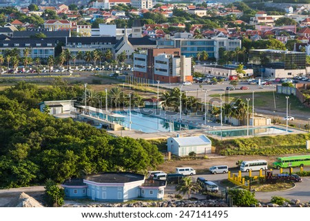 Colorful buildings and swimming pool in Curacao - stock photo