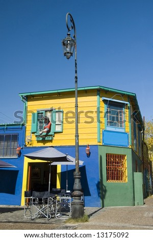 Colorful buildings decorate a street corner of the historic area of La Boca in the Argentinean capital Buenos Aires - stock photo