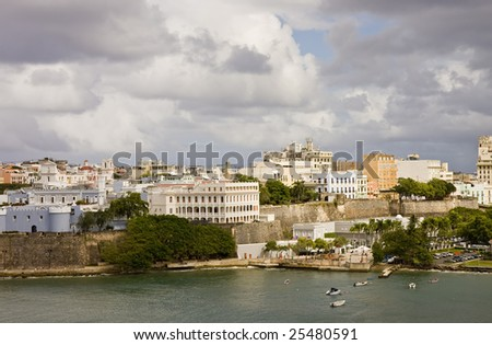 Colorful buildings in San Juan Puerto Rico under a cloudy sky - stock photo