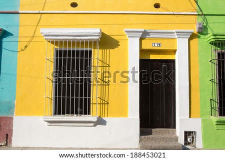 Colorful buildings in the historic center of Santa Marta, Colombia - stock photo