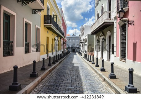 Colorful buildings on Calle Fortaleza & Governor's Mansion in Old San Juan, Puerto Rico - stock photo