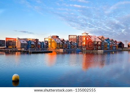 colorful buildings on water at Reitdiephaven during sunrise, Groningen