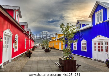 Colorful buildings with shops and restaurants in the village of Siglufjordur, Iceland