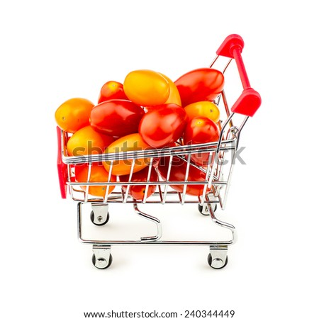 Colorful bunch of small grape tomatoes in shopping trolley isolated on white - stock photo