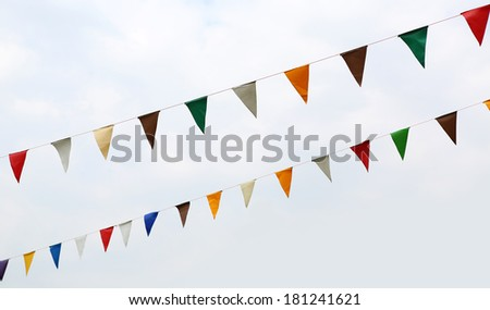 colorful bunting flags  against a sky - stock photo