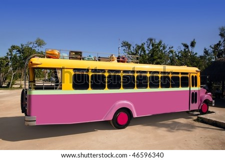 Colorful bus yellow and pink touristic tropical vehicle [Photo Illustration] - stock photo
