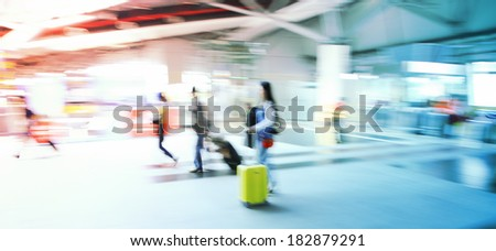 colorful business people busy in train station  - stock photo