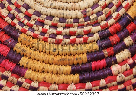 colorful but well used African basketry cooling pad detail - stock photo