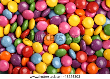 Colorful button-shaped candies filled with chocolate (chocolate beans) - stock photo