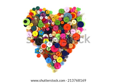 Colorful buttons in the shape of a heart.