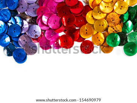 Colorful buttons on white background: blue, pink, red and yellow. Plenty of copy space. I have kept the very slight shadows to maintain realism.  - stock photo
