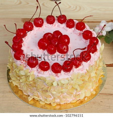 Colorful Cake Decorated with Cherries - stock photo