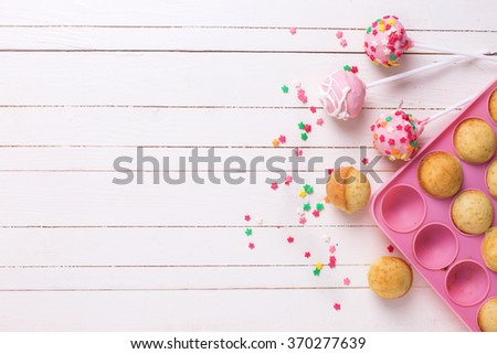 Colorful  cake pops on white wooden background. Selective focus.Place for text.