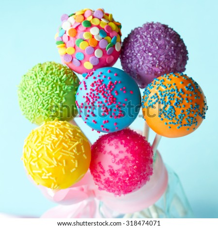 Colorful cake pops tied with a ribbon - stock photo
