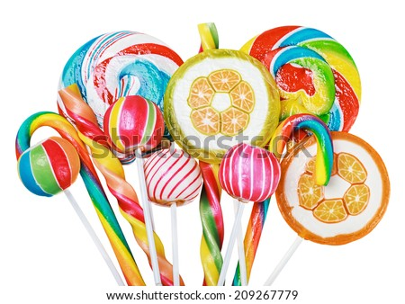 Colorful candies and lollipops isolated on white background - stock photo