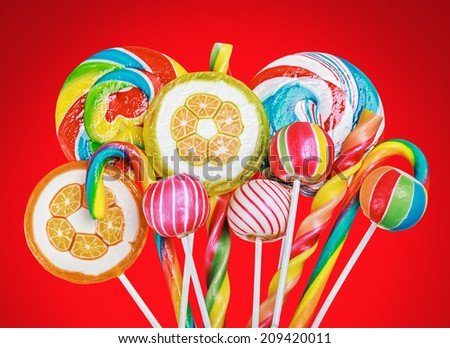 Colorful candies and sweets on a red background - stock photo