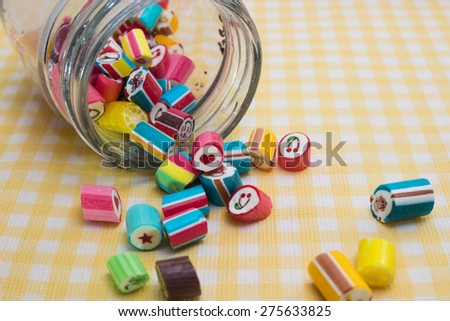 Colorful candies in a glass jar - stock photo