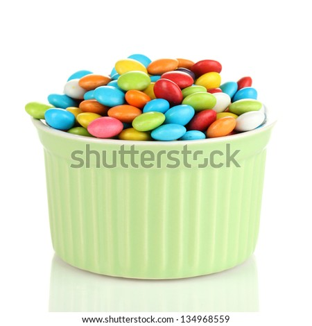 Colorful candies in bowl isolated on white - stock photo