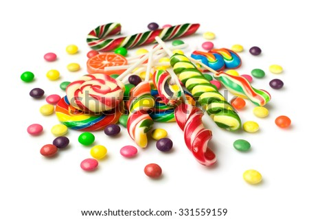 Colorful candies isolated over white - stock photo