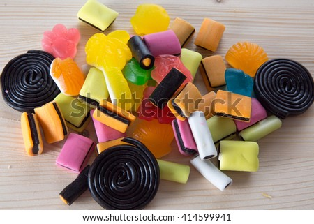 Colorful candies on a wooden table background