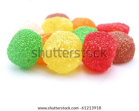 Colorful candies on white - stock photo