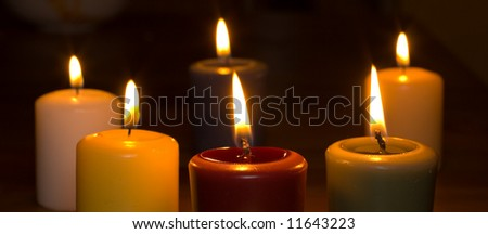 Colorful candles against dark background