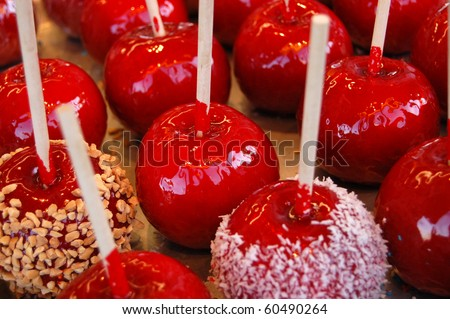 Colorful candy apples for sale at a country fair