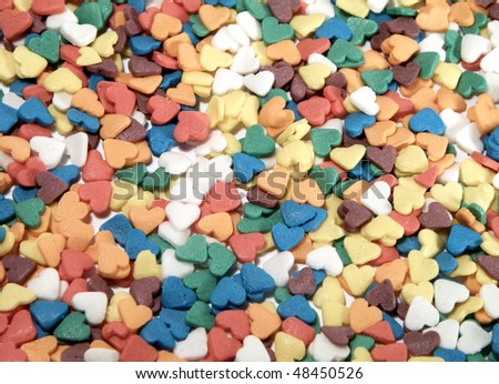 Colorful candy background in the form of hearts - stock photo
