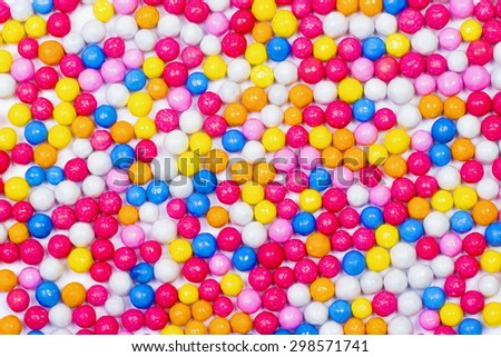 Colorful candy background, sugar sprinkle dots - stock photo