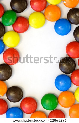 colorful candy border - vertical - stock photo