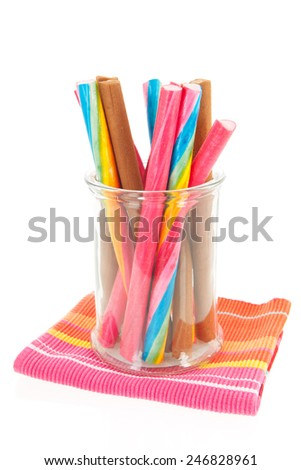 Colorful candy canes in different tastes isolated over white background - stock photo