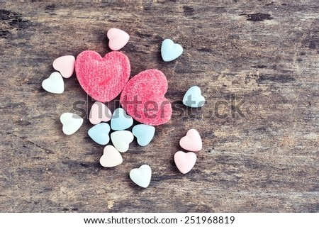 Colorful candy hearts on wooden. - stock photo