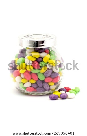 colorful candy in glass bottles on white background