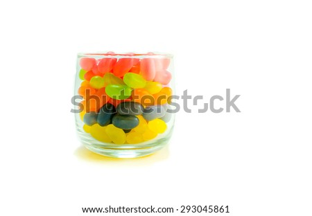 Colorful candy in glass on white background