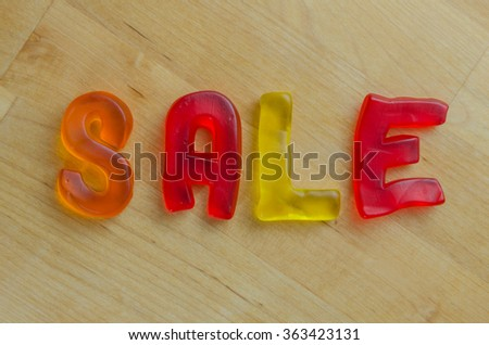 Colorful candy letters spell out the word sale