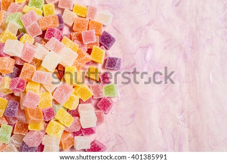 Colorful candy on pink background - stock photo