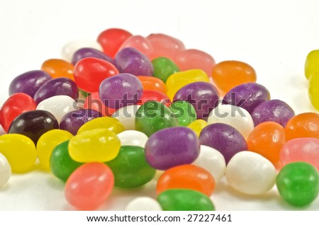 Colorful candy spread out in an isolated studio shot. - stock photo