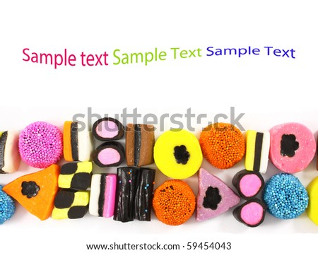 Colorful candy sweets with liquorice and space for text - stock photo