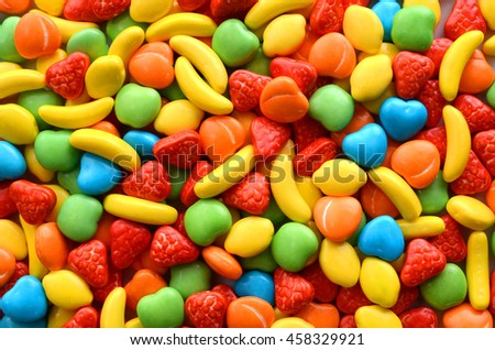 Colorful candy under water droplet background on glass surface - stock photo