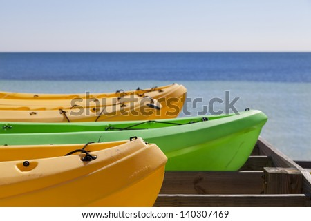 colorful canoes near the ocean - summer time image - stock photo