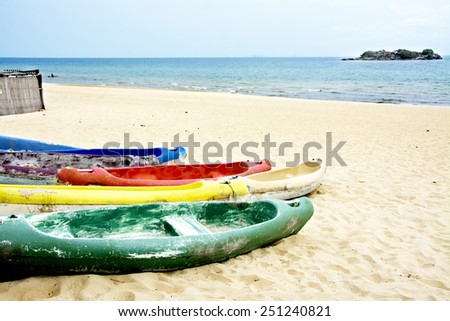 Colorful Canoes on the Beach of Lake Malawi - stock photo