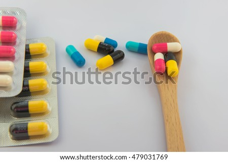Colorful  capsule drug on white  background