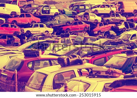 Colorful car wrecks top of each other in the scrap yard - Scrap  - stock photo