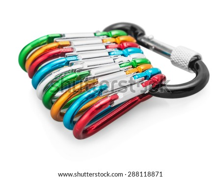 colorful carabiner climbing isolated on white. Focus on the carabiner clip in the middle of the frame - stock photo