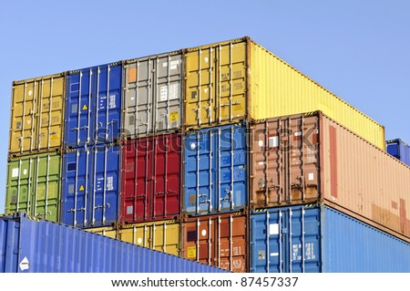 colorful cargo containers at warehouse - stock photo