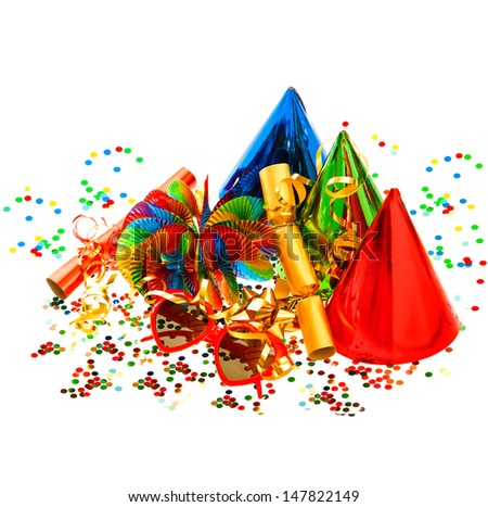 colorful carnival and birthday party decoration. garlands, streamer, cracker, glasses and confetti - stock photo